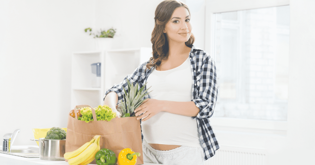 pregnant woman with grocery