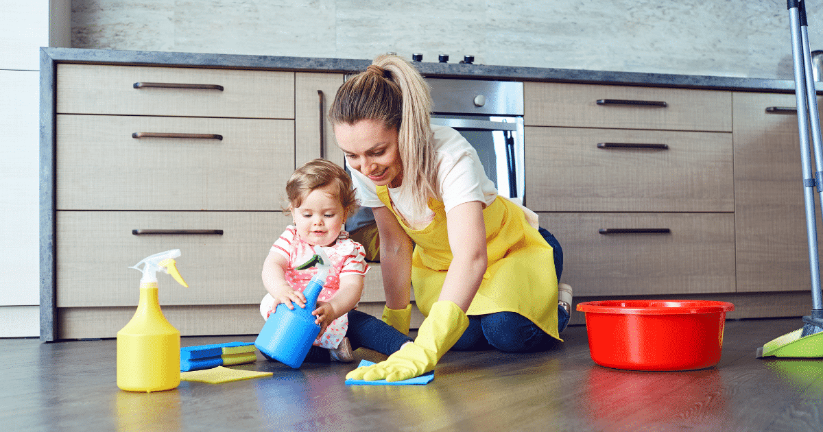 baby girl cleaning with mom