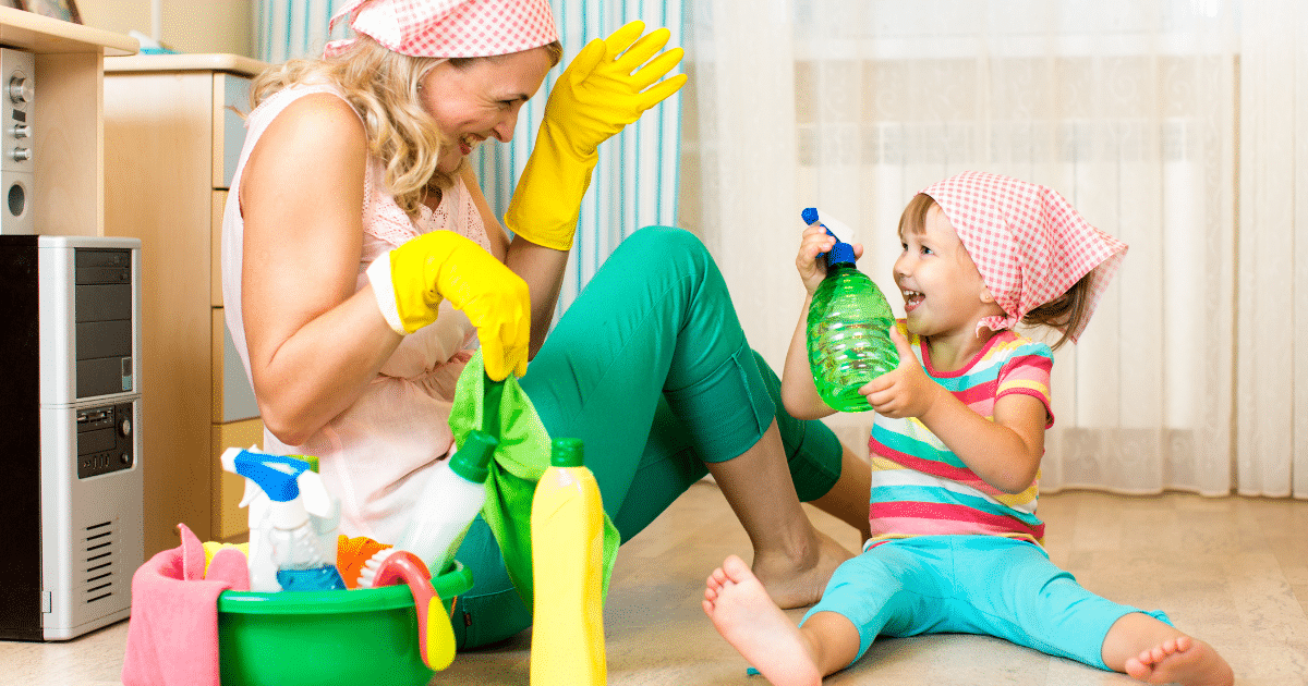Mommy and littler girl with cleaning supplies