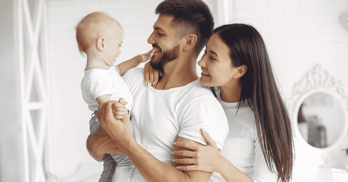 parents and baby smiling