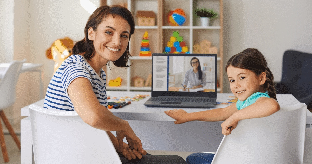 Mother and little girl doing an online lesson