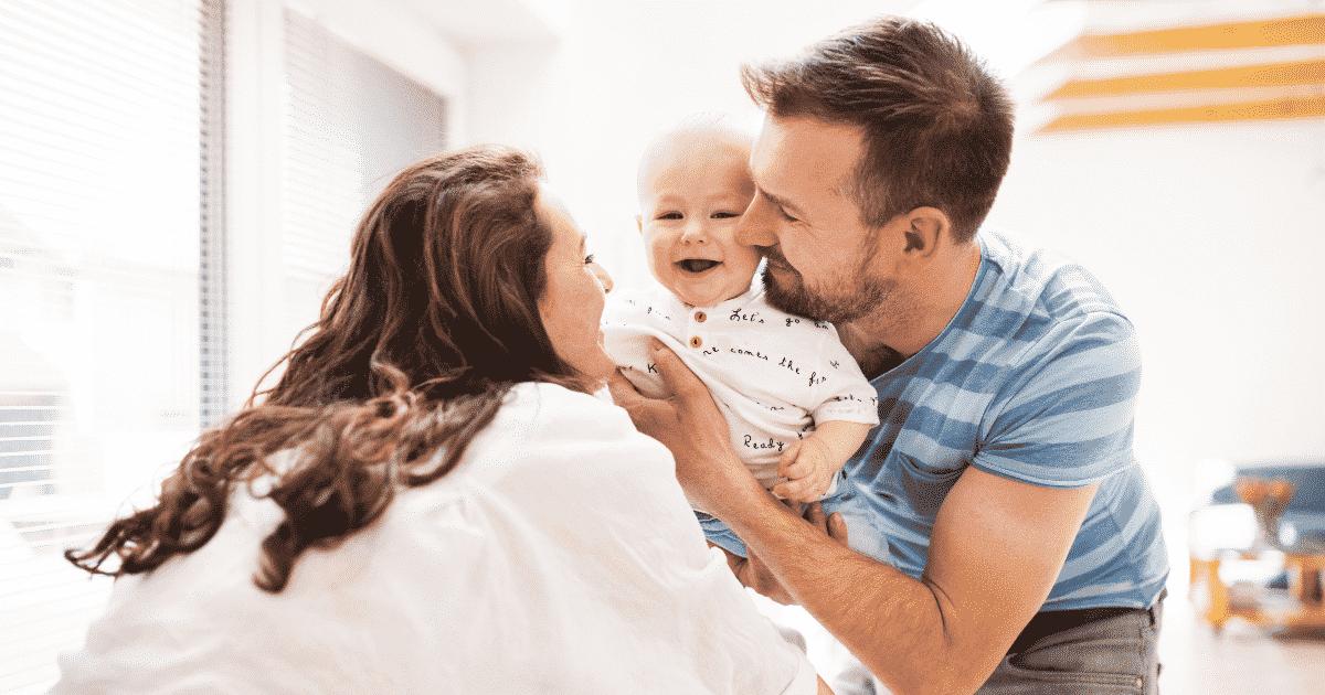 parents cheering baby