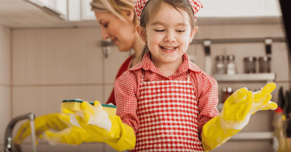 little girl washing plates